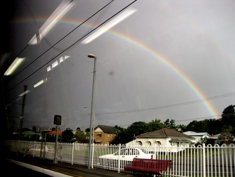 Rainbow out the train window