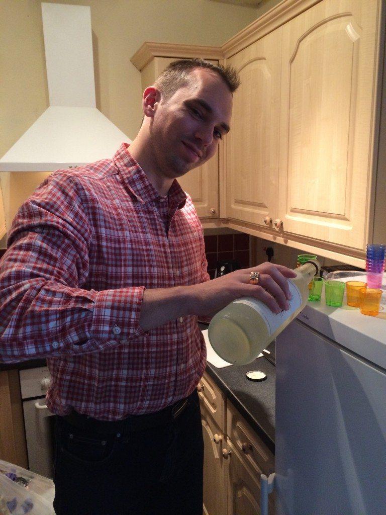 Martin pouring the akvavit